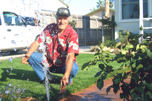 a Grand Prairie Sprinkler Repair tech repairs an irrigation line
